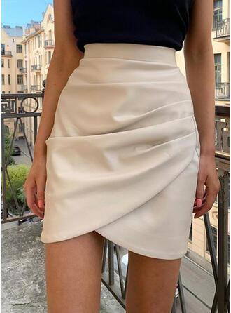 Kůže/PU Jednobarevný Délka ke kolenům Úzké sukně
